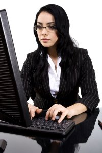 Business women working on office pc